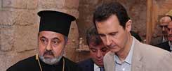 Letzte Hoffnung Assad: Syriens Machthaber besucht in Begleitung kirchlicher Würdenträger die Christenstadt Maalula, nachdem sie von seinen Truppen Ostern 2014 zurückerobert wurde  (Foto: Reuters/Sana)